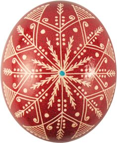 Pysanka with Star Rose motif which symbolizes Christ and God's love for man. White represents Purity, light, rejoicing, and virginity