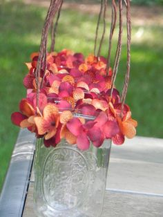 Hanging Candle Holders for Your Outdoor Wedding With Your Choice of Flower Color. $45.00, via Etsy.