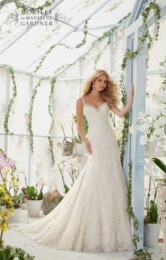 """EMBROIDERED EDGING WITH CRYSTAL BEADING MEETS THE ALENCON LACE APPLIQUES AND SCALLOPED HEMLINE ON THE NET GOWN Available in Three Lengths: 55"""", 58"""", 61"""". C"""