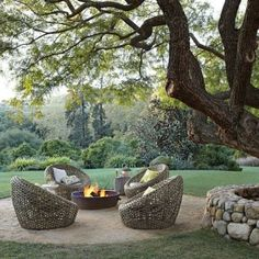 Fire pit under a tree - beautiful.