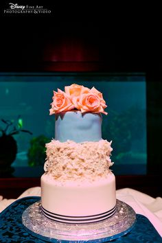 Pink and blue three tier wedding cake with texture and fresh floral