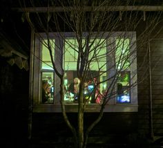 Looking through the night time window of Ariana Restaurant in Bend, Oregon....and  capturing a slice of life moment....