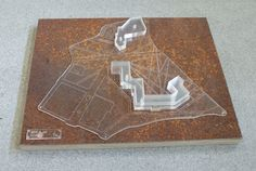 Site model scale 1:1000 Made from laser cut perspex mounted onto rusted metal sheet with plywood backing.