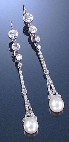 PAIR OF PEARL AND DIAMOND EAR PENDANTS, 1920s Each designed as an articulated line of millegrain- and collet-set circular- and single-cut diamonds, terminating on a similarly-set stylised loose ribbon suspending a framed pearl drop, case by Spink  Son Ltd, 5,6  7 King Street, St Jamess, SW: