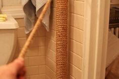 17 Simple Ways to Beautify a Small Bathroom Without Remodeling: Dress Up an Ugly Water Pipe