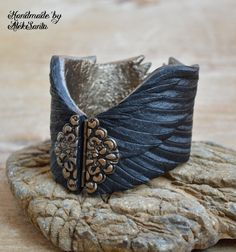 Raven wing bracelet Black feather cuff Gothic jewelry Polymer clay jewelry for women Statement bracelet Unique bracelet Gift for her .hba by HandmadeByAleksanta on Etsy