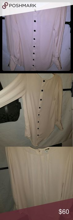 Mono B size medium oversized blouse Mono B size medium oversized blouse. With button up detail in the back and it's longer in the back then it is in the front. Like new can be worn with any outfit on any occasion dressed up or with jeans and heels mono b Tops Blouses