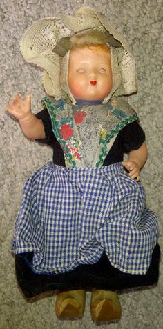 Dutch  My doll looked just like her...she was dressed with cousins clothing and hair.  She had/has the springy coils in her bonnet.