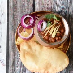 Chole Bhature is one of the tempting and flavorful dishes from Punjabi Cuisine. The union of Chickpea Curry and Fried Flatbreads is known as Chole Bhature. Pakora Recipes, Paratha Recipes, Paneer Recipes, Indian Veg Recipes, Indian Dessert Recipes, Indian Snacks, Bhatura Recipe, Chaat Recipe, Spicy Recipes