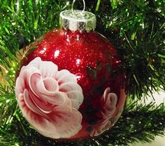 Hand Painted Red Glitter Christmas Ornament with Light Red and White Rose. $6.00, via Etsy.