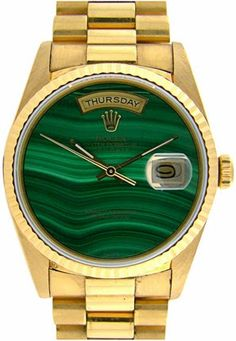 gold and malachite rolex