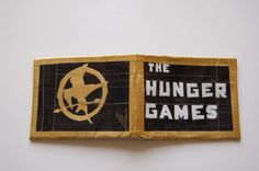 """For those Suzanne Collins fans out there:  """"The Hunger Games"""" wallet made out of duct tape and featuring the mockingjay pin. (By DuctTapeRebekah on Etsy)"""