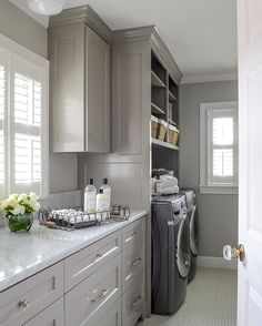 Galley laundry room layout with great storage. Galley laundry room layout with great storage. Grey Laundry Rooms, Laundry Room Layouts, Laundry Room Remodel, Laundry Room Cabinets, Laundry Closet, Grey Kitchen Cabinets, Laundry Room Organization, Laundry Room Design, Laundry In Bathroom
