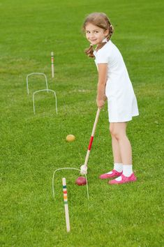 playing croquet in the yard