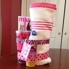 gift idea. I saw a pic of something similar and this is my version. It is a beach towel, sunscreen, insulated water cup with straw filled with starburst and a magazine.
