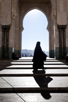 Casting A Shadow ~ A woman passing by one of the outside gates of the Hassan II Mosque in Casablanca, Morocco ~  Photo by...Gilad Benari©
