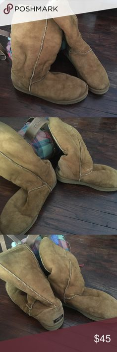 UGG Women Long Winter Boots I wanna start off by saying this is really bad lighting that makes them look faded. They are camel color and are in good used condition. Selling for a friend. Minor wear on the outside inside is good! UGG Shoes Winter & Rain Boots
