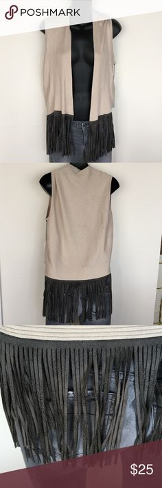 Cream Sweater Vest with Faux leather Fringe One size Central Park cream sweater vest with faux grey leather fringe around the hem.  New with tags.  Just wasn't able to mix in my wardrobe.  Smoke free, pet free home. Central Park West Sweaters