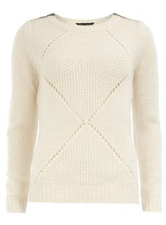 Knitted jumper with copper elbow patches and shoulder accents.