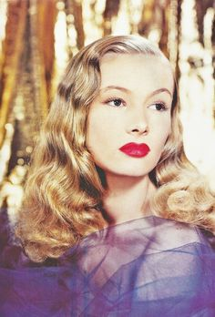 Veronica Lake - iconic 40's beauty.  It was the hairstyle!