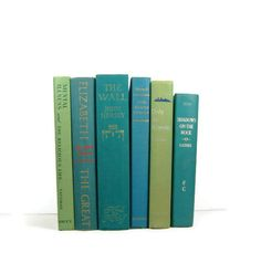 Vintage books stacked. We could find our own at DI or something but these are a great way to add sophisticated color to accessories.