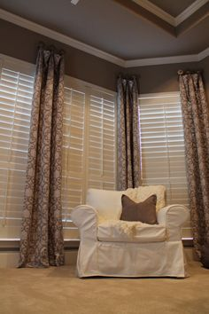 I love the texture of these draperies. Who says shutters alone are all you need?