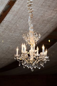 gorgeous chandelier to glam up a rustic venue  Photography by jessedanielsphotography.com