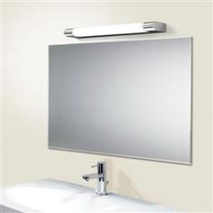 HiB Skylite LED Mirror Light 23300 23400 The Skylite LED mirror light has a unique style to give an amazing classic look to your overall bathroom. Bathroom Mirror Lights, Mirror With Led Lights, Led Mirror, Bathroom Lighting, Mirrors, Edison Bulb Light Fixtures, Hanging Light Fixtures, Bathroom Light Fixtures, Copper Lighting