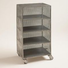A dapper addition to the home office, this spacious four-shelf piece is crafted of punched metal, finished in zinc and mounted on castors that swivel and lock.