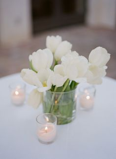 style me pretty - real wedding - usa - california - rancho santa fe wedding - the crosby at rancho santa fe - reception decor - table decor - centerpiece - tulips
