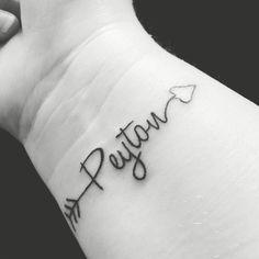 Arrow name tattoo.