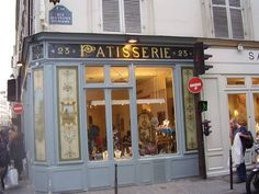 Thanks to a policy that protects many of the Marais' historical buildings, it is not uncommon to see contemporary boutiques move into former bakeries or other shops, preserving the original facades. Here, a fashion boutique on Rue des Francs-Bourgeois is housed in a historic bakery and pastry shop.