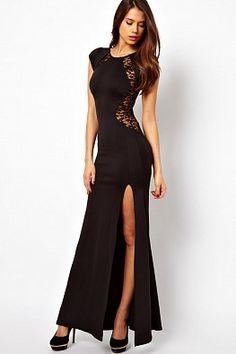 Длинное вечернее платье черного цвета с пикантным разрезом
