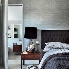 Neutral modern bedroom. I'd add a few pops of color but I love the walls and headboard