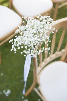 Maybe for the ceremony...something pretty but still inexpensive and ties it to the reception with the baby's breath?