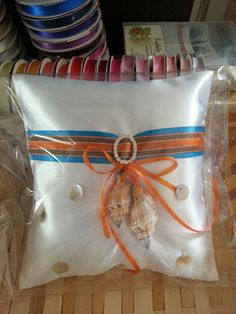 Custom made ring pillow.  Theme: Orange & Blue, Under the sea. The client was happy:-)