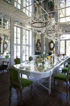 House tour: the fairytale château of Les Trois Garcons: The château's interior is now filled with pieces that span centuries and continents, placed in an eclectic style emphasising symmetry and beauty. In the dining room is a table that once belonged in a Paris library, from the Clignacourt antiques market. Baroque mirrors from Lisbon, and plasterwork and columns from London complete the setting, lit in the evenings by four Italian chandeliers, circa 1810.