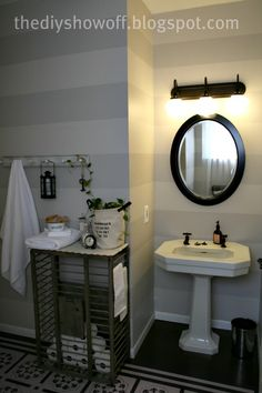 I think this is how I'm going to re-do my guest bath. I love the stripes and the pedestal sink, classy like me