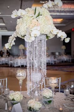 The jewels hanging from this centerpiece really adds an element of elegance.