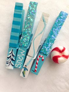 PAINTED CHRISTMAS CLOTHESPINS   glitter snow covered trees candy canes snowboarder magnets by SugarAndPaint on Etsy