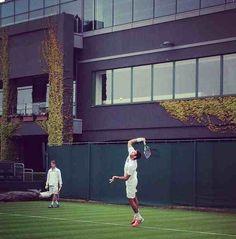Juan Martin del Potro reaches to serve on the practice courts. // Wimbledon, come to mama!