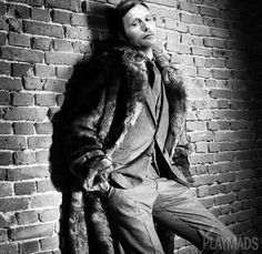 PlayMads. Mads Mikkelsen, hottie, Danish Actor, celeb, brick wall, up against the wall, b/w