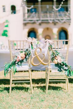 Photography by Catherine Ann Photography   florals by Elegant Designs Floral   Powel Crosley Estate, Sarasota, Florida   gold ampersand chair sign for bride and groom, gold chiavari sweetheart chairs