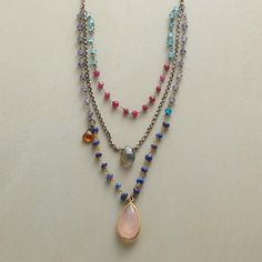 "THREE AMIGOS NECKLACE -- Faceted labradorite, hessonite garnet and pink chalcedony framed in 24kt gold plate, play nice on a triple-tiered necklace shining with lapis, ruby, apatite and tanzanite. Sterling silver chain and clasp. 17""L. designed by nicole ardis jewelry."