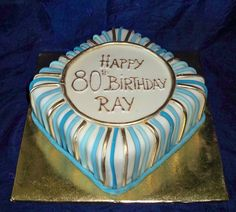 blue and gold for an 80th birthday http://www.elisabethscakes.com.au