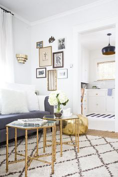 If you favor metallic hues, keep larger pieces like your sofa and rug neutral. A simple palette makes for a sleek foundation so accessories can stand out.