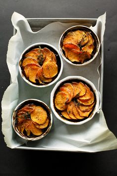 """Mushroom and stout pot pies are a hearty vegan main course with a fanned sweet potato """"crust"""" on top."""
