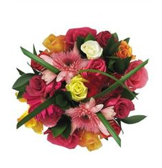 Romantic Rainbow  A bouquet of mixed roses & gerberas wrapped in brown paper & tied with a raffia bow.