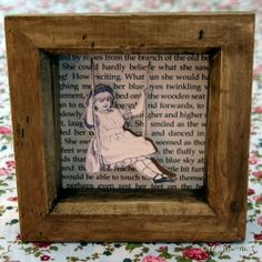 This lovely framed paper cuts features a young girl on a swing coming out of the page...