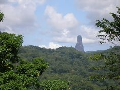 Pico Cao Grande, Sao Tome and Principle  http://www.amusingplanet.com/2013/07/pico-cao-grande-towering-volcanic-plug.html  http://peakery.com/pico-cao-grande-sao-tome-and-principe/